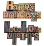 Happy holidays and vacations. A collage of isolated text in vintage wood letterpress printing blocks Royalty Free Stock Photos