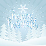 Happy Holidays. Vector Illustration. Hand Lettered Text with Trees and Snow on a Blue Background vector illustration