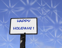 Happy Holidays with white fireworks Stock Photography