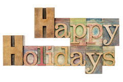 Happy Holidays in wood type royalty free stock image