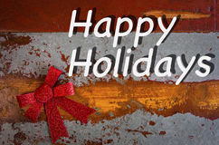 'Happy Holidays' on wooden board Stock Photo
