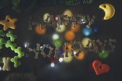 Happy Holidays written with dog treats Stock Photography