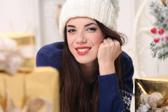 Happy hollyday. Happy young woman celebrating Christmas at home Stock Photos