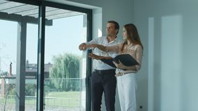 Happy home owners planing design interior. Cheerful family emotion. Happy home owners planing design interior. Portrait of happy couple planing home interior stock footage
