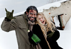 Happy homeless couple drinking Royalty Free Stock Images
