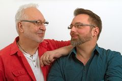 Happy homosexual couple. On bright background. Shot in studio stock image