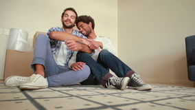 Happy homosexual couple with new house key. In high quality format stock video