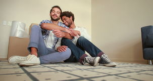 Happy homosexual couple with new house key stock video