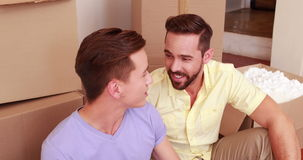 Happy homosexual couple speaking and drinking stock video footage