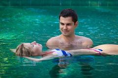 Happy honeymoon in a swimming pool Stock Image