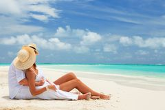 Happy honeymoon vacation at Paradise. Couple relax Royalty Free Stock Image