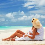 Happy honeymoon vacation at Paradise. Couple relax. On the white sand of beach. Happy sea lifestyle. Young family, men and women rest on the beach of ocean Stock Photo