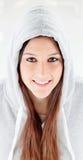Happy hooded girl with grey sweatshirt Stock Photos