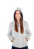 Happy hooded girl with grey sweatshirt looking at side Royalty Free Stock Photos