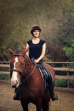 Happy Horsewoman Ridding  in a Manege Stock Photo