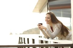 Happy hotel guest holding coffee looking at you stock image