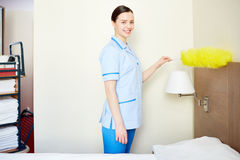 Happy hotel maid Royalty Free Stock Image
