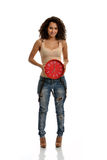 Happy Hour. A pretty young lady holding a clock indicating happy hour stock photo