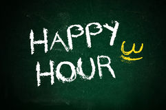 Happy hour. Written on green chalkboard with chalk Stock Photography