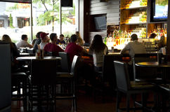 Happy hour at bar restaurant. People were drinking and watching TV at a bar restaurant of a hotel in Downtown Bellevue, Washington State, USA Stock Photography