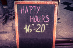 Happy hour board with text. Written in chalk Royalty Free Stock Photo