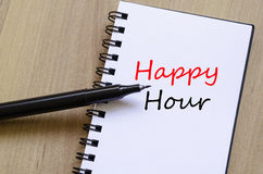 Happy Hour Concept Notepad. White notepad and ink pen on the wooden desk Happy Hour Concept Royalty Free Stock Images