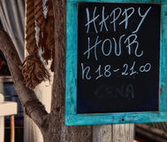 Happy Hour indication. Happy hour blue indication on the beach Royalty Free Stock Photography