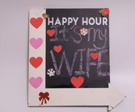 Happy hour its my wife blackboard. Sign. happy hour its my wife written with chalk on black chalkboard with frame stock images