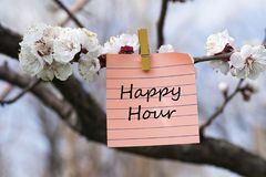 Happy hour in memo. Pined on tree with blooms Royalty Free Stock Images