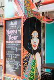 Happy hour menu. Singapore - 22nd December 2018: Happy hour menu outside bar on Haji Lane. This is in the Kampong Glam area royalty free stock image