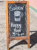 Happy Hour. At the saloon, sidewalk sign Royalty Free Stock Image