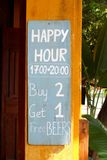 Happy Hour sign board, Free Beers, Asia. Happy Hour sign board, Buy two get one and free beers at the entrance of a cafe bar, Asia royalty free stock images