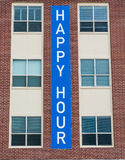 Happy Hour Sign on Brick Royalty Free Stock Photo