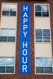 Happy Hour Sign on Building Stock Image