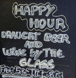 Happy hour sign. Chalk board with a happy hour sign Stock Images