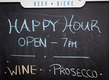 Happy hour sign in St John. Happy hour sign on a chalkboard in St Johns Newfoundland stock images
