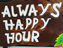 Always happy hour. Wooden craved sign Royalty Free Stock Photography