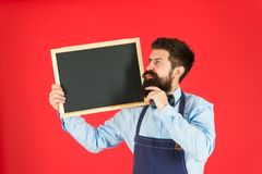 Happy hours bar. Hipster bartender show blackboard copy space. Hipster restaurant staff. Hipster informing you. Man. Bearded bartender or cook in apron hold royalty free stock images