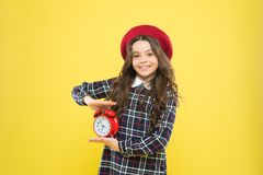 Happy hours concept. Schedule and timing. Girl with alarm clock. Set up alarm clock. Child little girl hold red clock. It is time. Always on time. It is never stock images