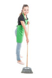 Happy house maid using brush for the floor Stock Image