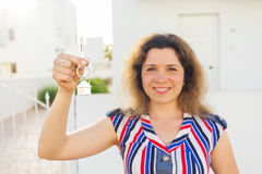 Happy house owner or renter showing keys and looking at you Royalty Free Stock Image