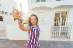 Happy house owner or renter showing keys and looking at you Royalty Free Stock Photos
