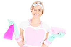 Happy housekeeper. A portrait of a happy housekeeper in retro style posing over white background Stock Image