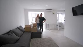Happy housewarming, merry young family carry boxes and enjoy purchase new flat. Happy housewarming, merry young family carry cardboard boxes and enjoy purchase stock footage