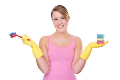Happy housewife. Full isolated portrait of a beautiful caucasian woman with some cleaning equipment Stock Photo