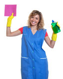 Happy housewife with blond hair and damp cloth Royalty Free Stock Photos