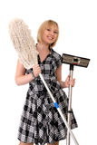 Happy housewife with broom Stock Photo