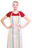 Happy housewife or chef in colorful kitchen apron Stock Photography