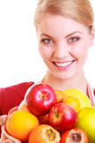 Happy housewife or chef in kitchen apron offering fruits isolated Stock Image