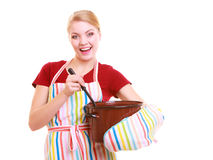 Happy housewife or chef in kitchen apron with pot of soup ladle Stock Photography